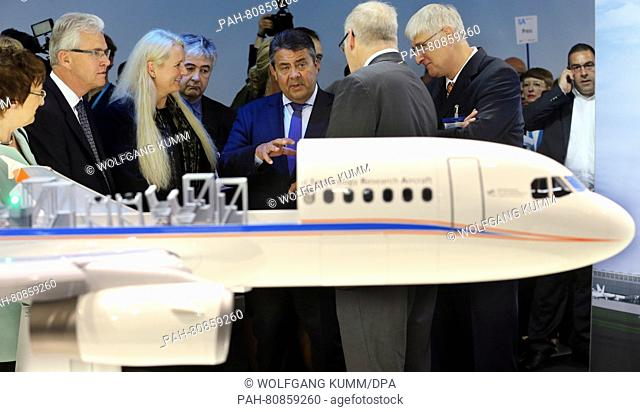 German Economics Minister Sigmar Gabriel (SPD, M), visting the stand of DLR at opening tour of the ILA Berlin Air Show in Berlin, Germany, 01 June 2016