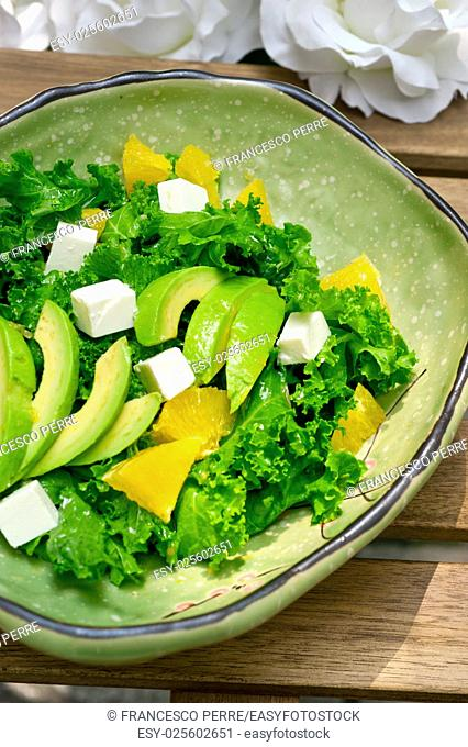 fresh avocado salad with orange pulp and feta cheese