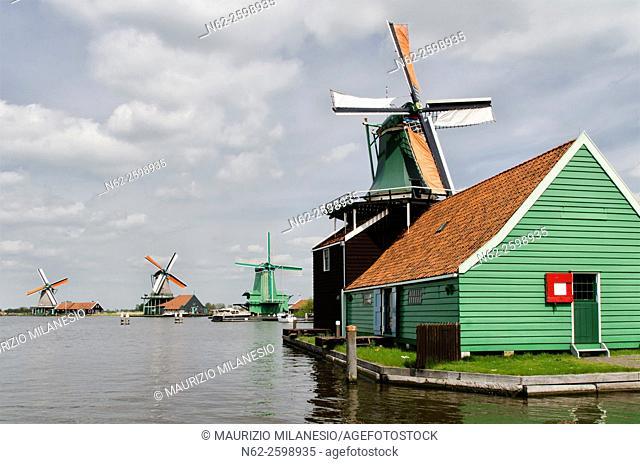 Windmills near the water canal at Zaanse Schans, Amsterdam, Holland