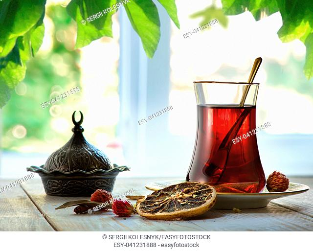 Compostion with fresh turkish tea on a background of window