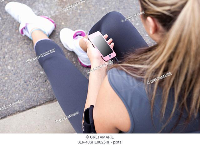 Runner listening to mp3 player outdoors