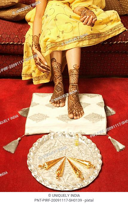 Bride's feet with henna decoration