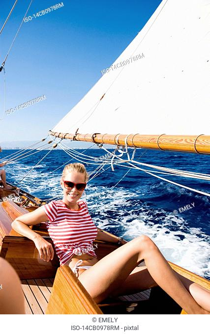 woman smiling sitting on deck