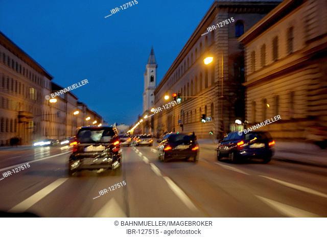 Munich Ludwigstrasse Schwabing Bavaria germany by night with lights traffice in motion