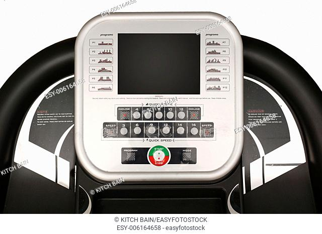 An exercise treadmill on a plain background