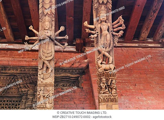 Recently restored religious carvings adorn a temple at Durbar Square in Patan, Nepal