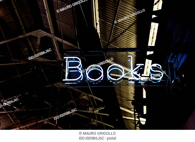 Illuminated neon bookshop sign at night, New York, USA