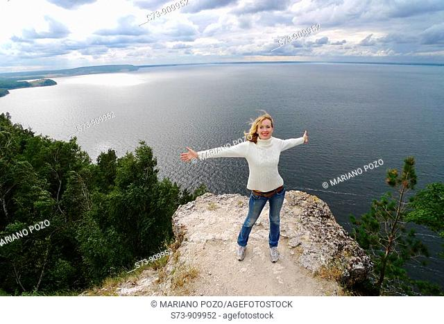 30 years old woman jumping in Molodeskiy Kurgan National Park in Toglyatty, Samara Region, Russian Federation, Russia