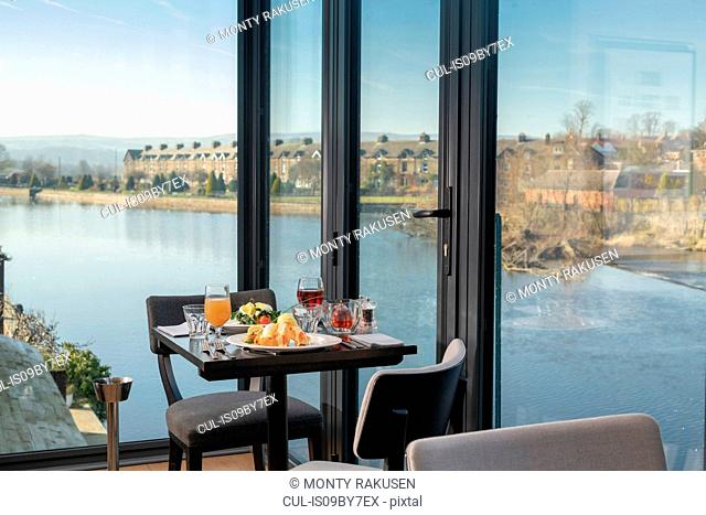 View of river with table setting at Italian restaurant