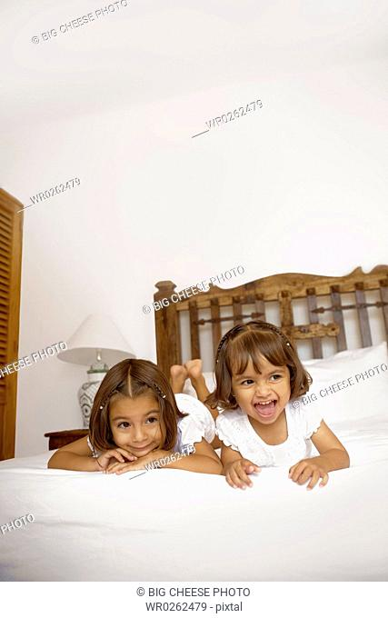 Two girls lying on the bed