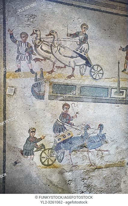 wide shot of the Roman mosaics of the room of the Small Circus depicting Roman boys riding small chariots pulled by birds in a small circus