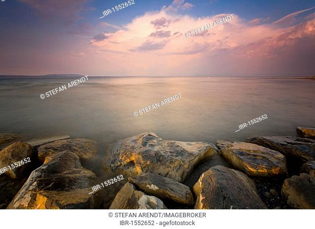 Stormy atmosphere and the rocky shore of Lake Constance, Altnau, Switzerland, Europe