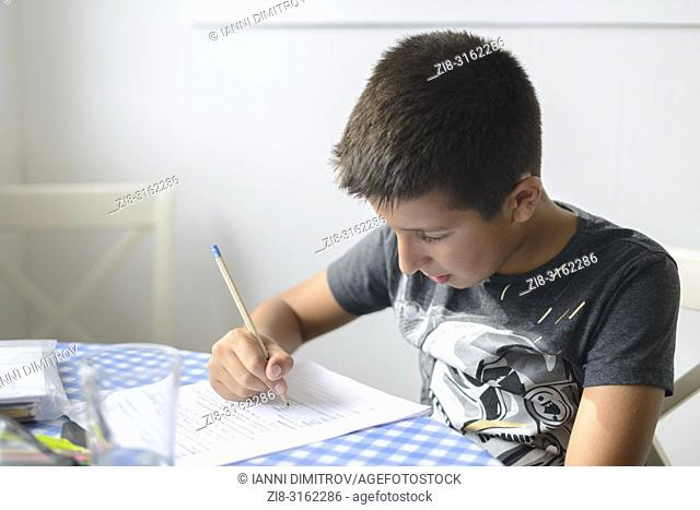UK,Surrey-Child revising for 11+ (eleven plus) exams during summer holidays-selective focus