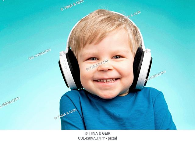 Little boy wearing headphones and smiling