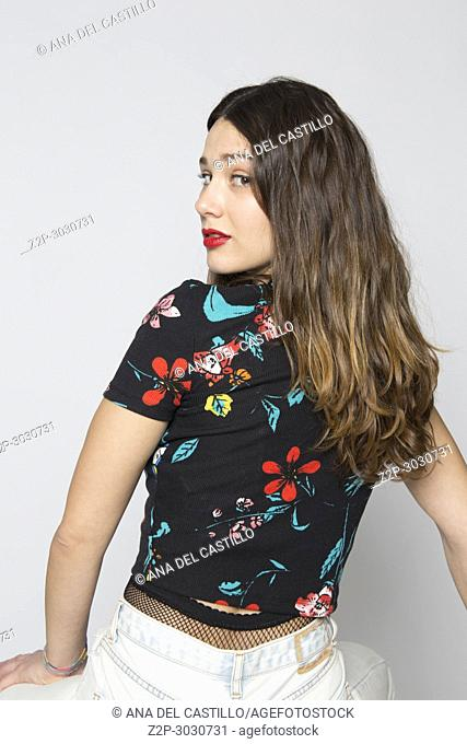 Studio shot of the back of young slim woman in jeans
