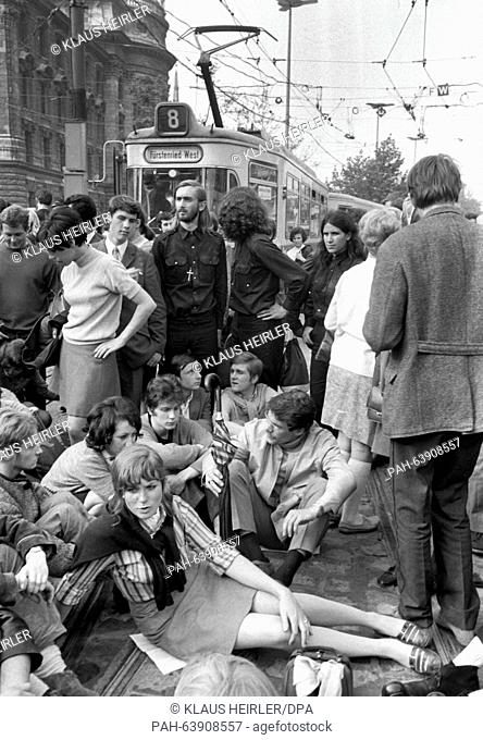 Demonstrators block the tram lines at Stachus in Munich. Thousands of students, workers and employees demonstrated on 29 May 1968 against the third reading of...