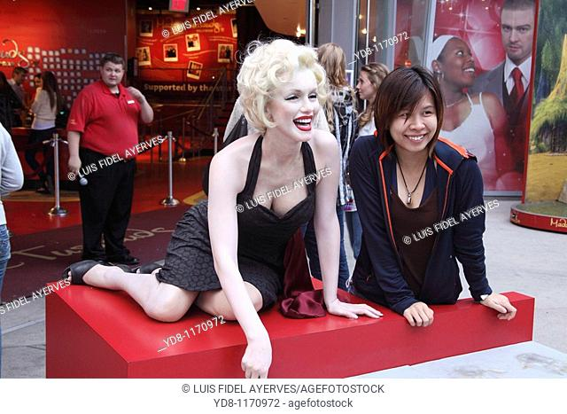 Tourist with Marilyn Monroe on the Walk of Fame, Hollywood, California, USA
