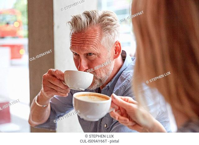 Mature man in coffee shop drinking coffee