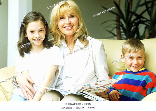 Portrait of a mature woman with two children