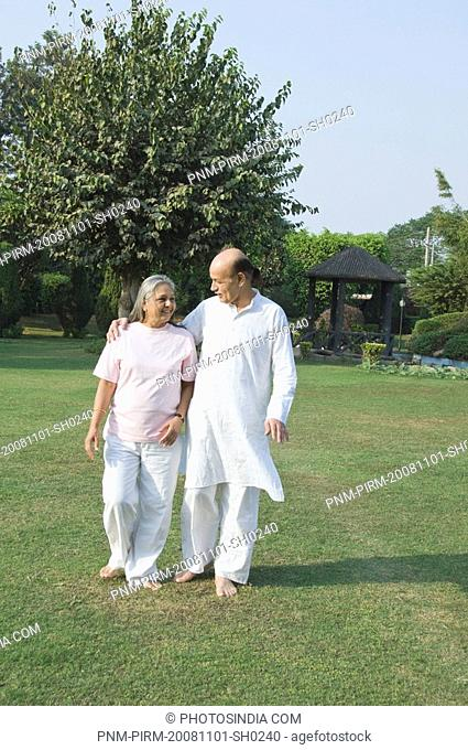 Couple walking in a park, New Delhi, India