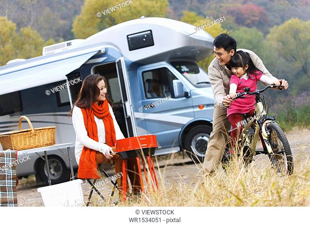 Parents and daughter outdoor camping