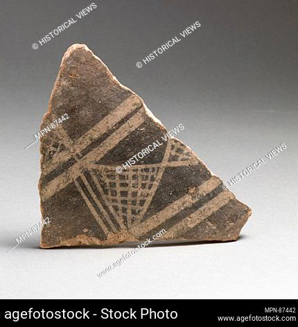 Terracotta vessel fragment with cross-hatched triangles and broad bands. Period: Early Minoan III; Date: ca. 2300-2100 B
