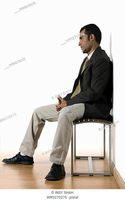Young man sitting waiting