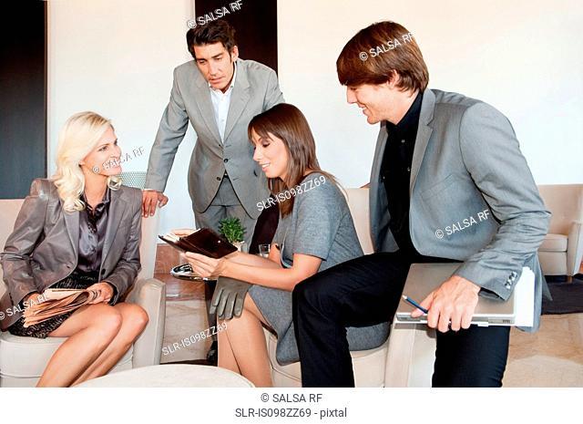 Businesspeople having informal meeting