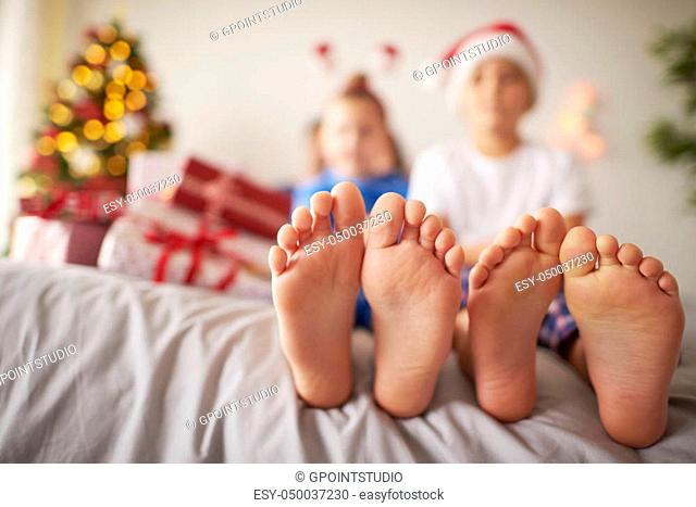 Kids feet in the bed at Christmas