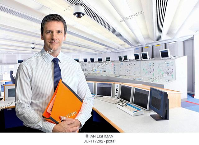 Technician In Control Room Of Nuclear Power Station