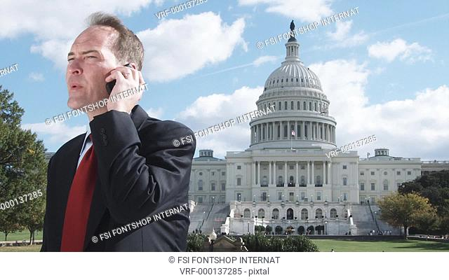 MS, Lockdown of a well-dressed man talking on a mobile in front of the US Capitol Building
