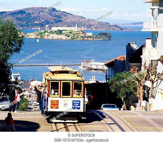 High angle view of passengers in a tram waving, Hyde Street, San Francisco, California, USA