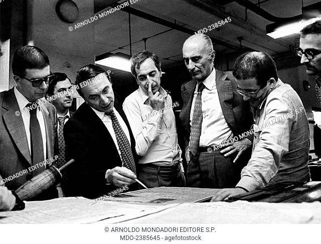 Italian journalist and editor in chief of Il Giornale Nuovo (Il Giornale) Indro Montanelli looking at the proof of the first page of the newspaper with Italian...