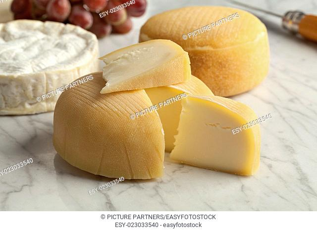French cheese platter with camembert, chaussee aux moines and grapes as dessert