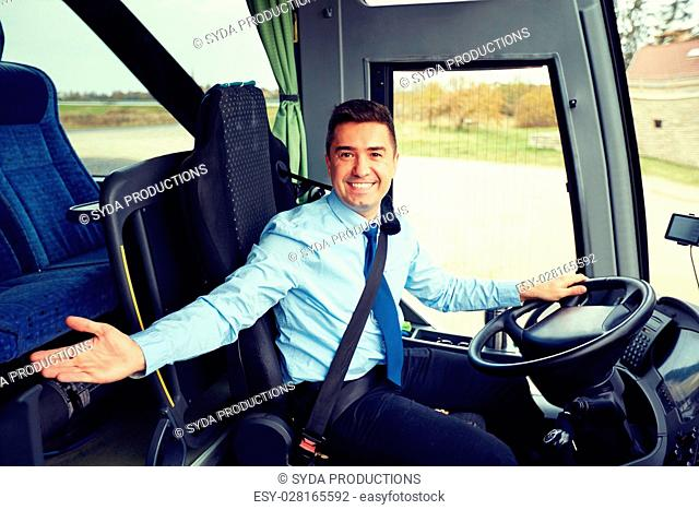 transport, tourism, road trip, gesture and people concept - happy driver inviting on board of intercity bus