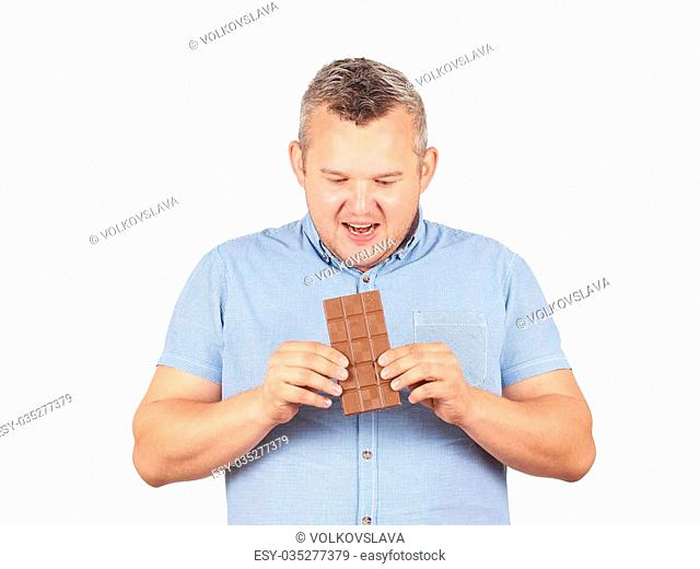 fat man wants to take a bite of chocolate. Diet, overweight, healthy food Isolated on white background