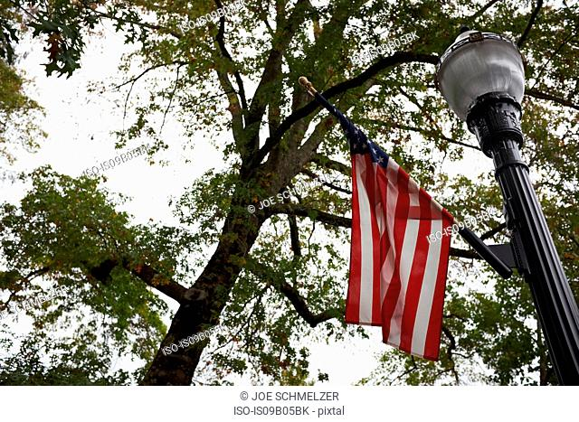 Low angle view of street lamp and American flag, California, USA