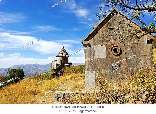 St. Nechan church (Surp Nshan, 11th century) and, in the background, the renovated Karapet church of Tsakhats Kar Monastery, near Yeghegnadzor