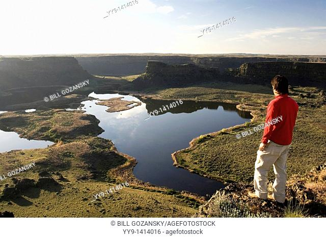 Person overlooking Dry Falls, Sun Lakes - Dry Falls State Park, Washington