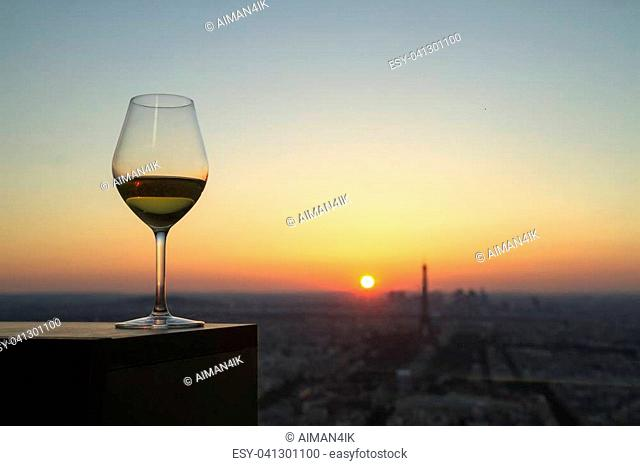 white Wine glass with view on paris city at sunset