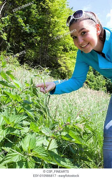 Girl shows stinging nettle leaves