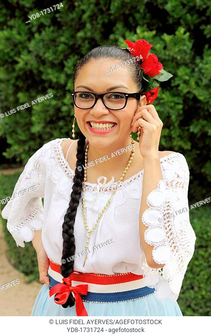 Young woman celebrating the week of cultures with their traditional dress malaga, Malaga province, Andalusia, Spain