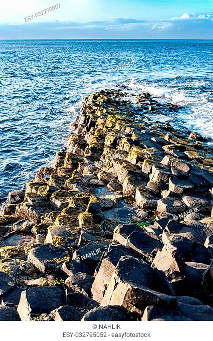 Giants Causeway geological formation in Antrim, Northern Ireland, in sunset light