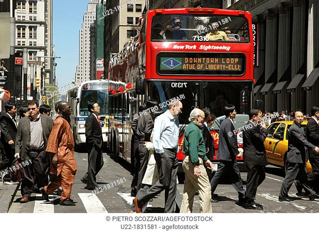 New York City, pedestrians crossing Broadway Avenue in the Financial District