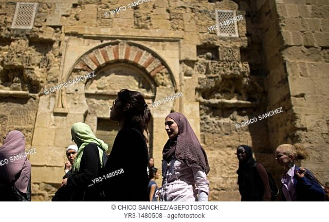 Muslim women walk outside the Mosque and Cathedral of Cordoba, Andalusia, Spain, April 17, 2010