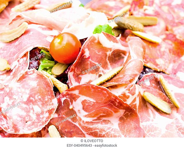 close up of tasty cold meats on the table