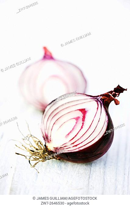 Red Onion halved on rustic wooden table