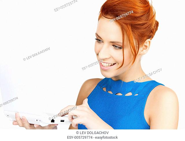 bright picture of smiling woman with laptop computer