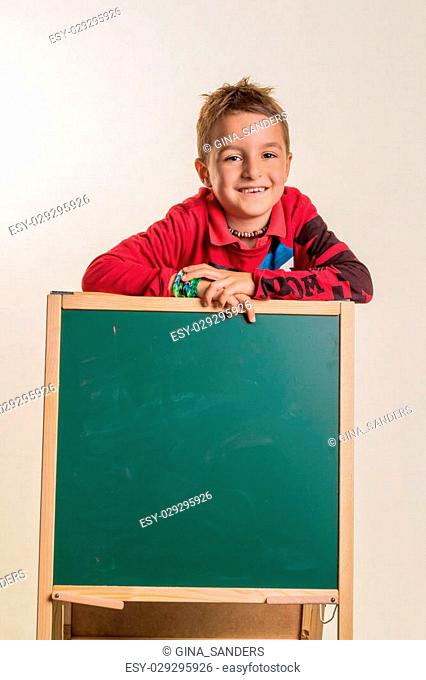 a child with a blank blackboard