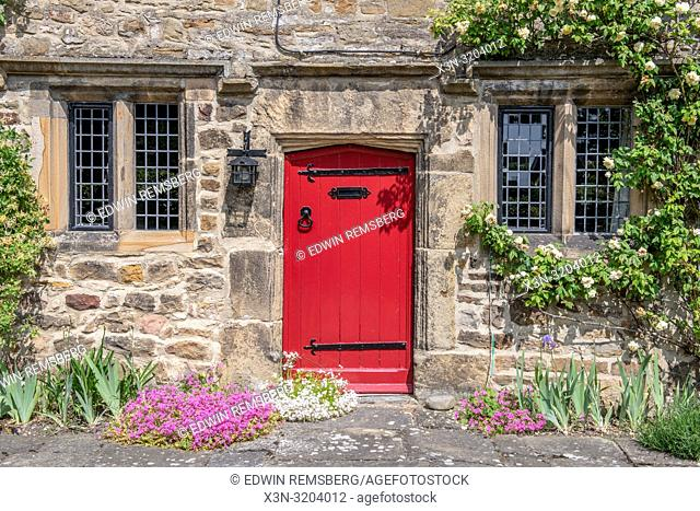 A bright red door marks the entrance to Kiplin Hall, Richmond, Yorkshire , UK